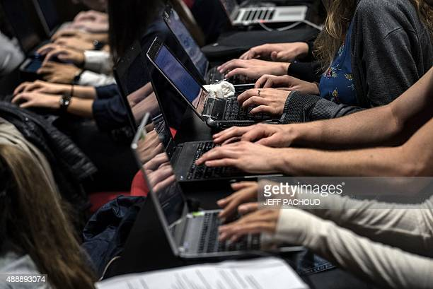 Students of the Catholic University of Lyon use laptops to take notes in a classroom on September 18 2015 in Lyon eastern France AFP PHOTO / JEFF...