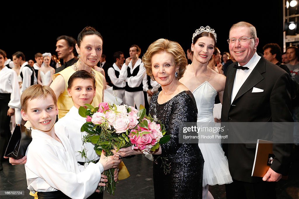 Students of the Dance School of Opera de Paris with Great Mecene of French school of dance Lily Safra, Star Dancer <a gi-track='captionPersonalityLinkClicked' href=/galleries/search?phrase=Aurelie+Dupont&family=editorial&specificpeople=2903830 ng-click='$event.stopPropagation()'>Aurelie Dupont</a>, Director of School Dance of Opera de Paris Elisabeth Platel (in yellow) and President of Opera de Paris Bernard Stirn on stage while Tricentenary of the French dance school, AROP Gala, at Opera Garnier on April 15, 2013 in Paris, France.