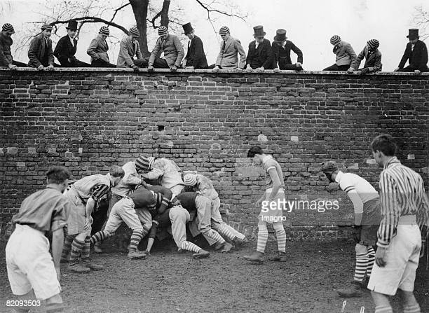 Students of the Eton College are playing the traditional Wall Game Photograph England Berkshire 1933 [Schler des Eton College beim traditionellen...