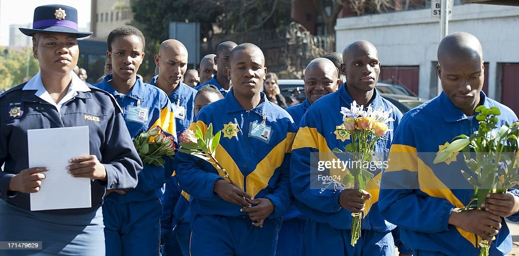 AFRICA - JUNE 25(SOUTH AFRICA OUT) Students of the Police academy lay down flowers outside the Pretoria Heart Hospital on June 25, 2013, in Pretoria, South Africa. Mandela's health is described as 'critical'.