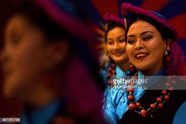 Students of The Tibetan Institute of Performing Arts perform a dance during a cultural event in Chennai on March 24 2017 / AFP PHOTO / ARUN SANKAR