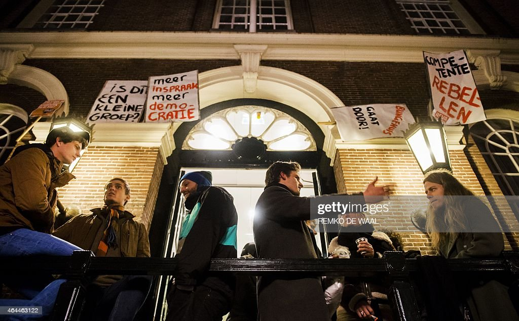 Students of the University of Amsterdam gather in front of the universitys administration centre Maagdenhuis in Amsterdam as they occupy the site on February 26, 2015. The students are demanding more democracy and transparency from the university authorities.