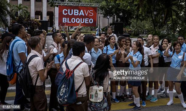 Students of the University of Havana in the Cuban capital on October 26 2016 celebrate after the UN General Assembly adopted a resolution calling for...
