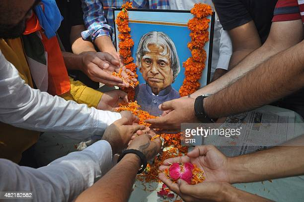Students of the University of Jammu pay tribute to former Indian President APJ Abdul Kalam in Jammu on July 28 2015 India's former president and top...