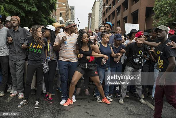 Students of the Witwatersrand University march in Johannesburg South Africa on October 21 2015 during a protest against fee hikes Universities in...