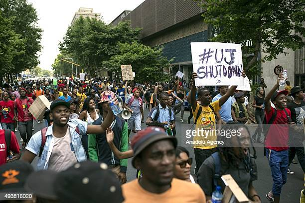 Students of the Witwatersrand University march in Johannesburg South Africa on October 21 2015 during a protest against fee hikes