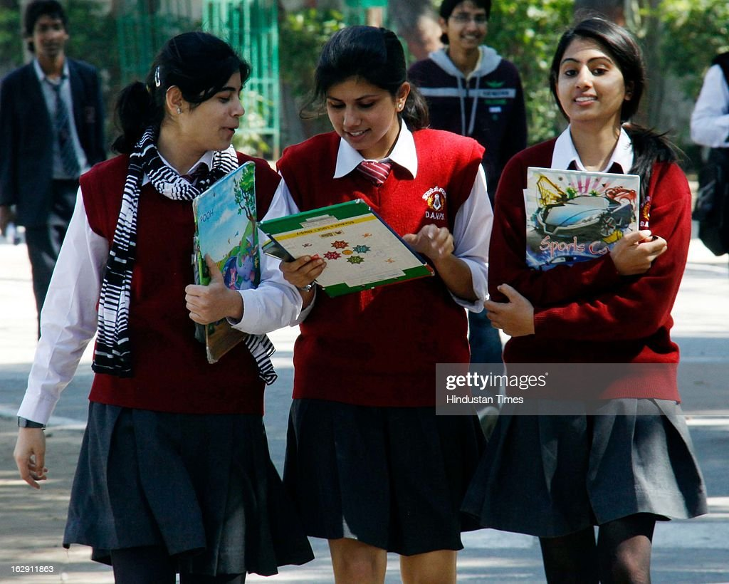 Students of xth class coming out after giving their painting exam of Central Board of Secondary Education (CBSE) Board Examinations on March 1, 2013 in Gurgaon, India. Over all 22 lakh students are appearing for their exam for Class X and XII this year.