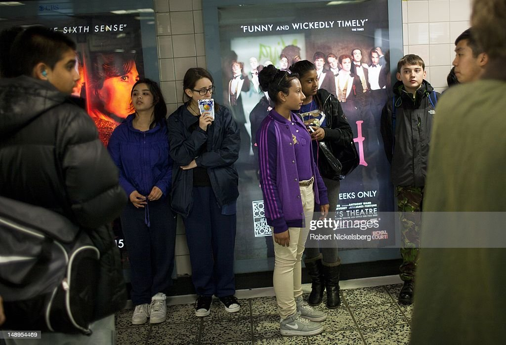 Students on a school trip gather inside the Elephant and Castle tube station in central London.