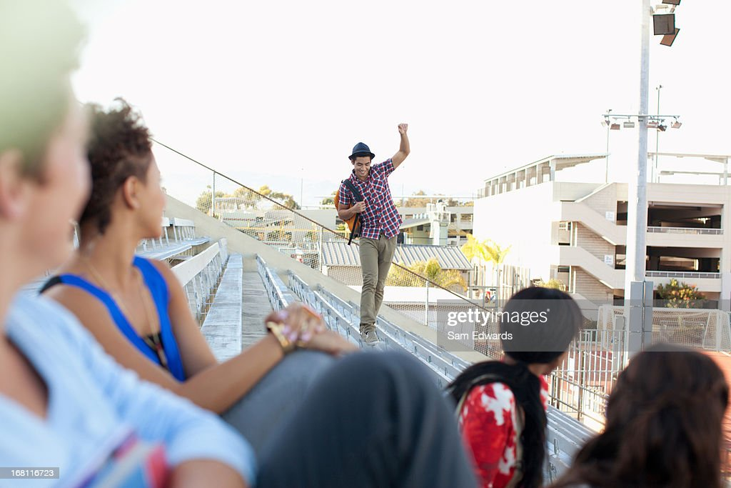 Students on bleachers : Stock Photo