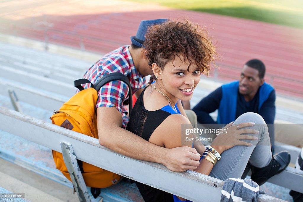Students on bleachers : Stock Photo