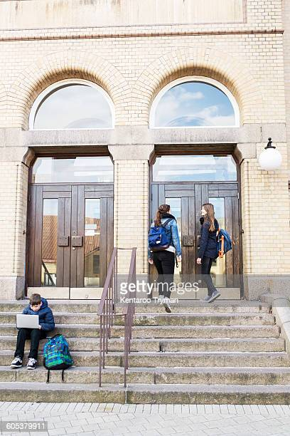 Students on steps of high school