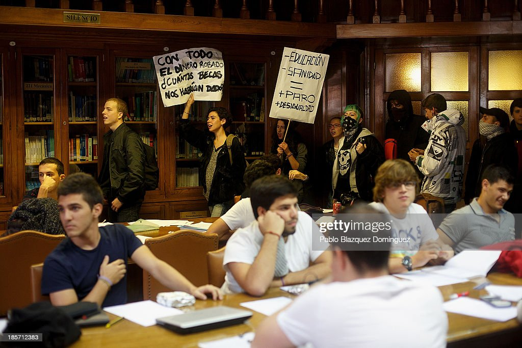 Students on strike enter shouting slogans and holding placards in School of Aeronautic Engineers' library in Ciudad Universitaria on October 24, 2013 in Madrid, Spain. The Spanish Parliament recently approved a controversial reform of the educational system, which passed by the ruling right wing People's Party (PP) using their absolute majority and not backed by any other political party. The students are on a three day strike to protest against the new law, which will need to be approved by the senate next month and are calling for the resignation of Education Minister, Jose Ignacio Wert.