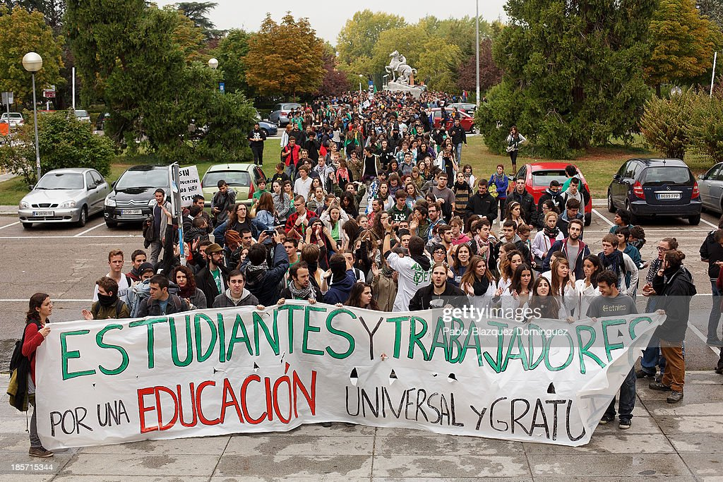 Students on strike hold a banner reading 'Students and workers for a universal and free education' in the streets of Ciudad Universitaria on October 24, 2013 in Madrid, Spain. The Spanish Parliament recently approved a controversial reform of the educational system, which passed by the ruling right wing People's Party (PP) using their absolute majority and not backed by any other political party. The students are on a three day strike to protest against the new law, which will need to be approved by the senate next month and are calling for the resignation of Education Minister, Jose Ignacio Wert.
