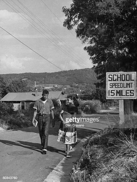 Students on their way hoem from classes at the recently desegregated Clinton High School Clinton Tennessee early September 1956 Pictured are Bobby...