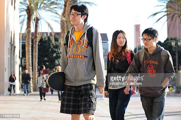 USC students on their way to attend a memorial service on April 18 2012 in Los Angeles California for the two Chinese graduate students who were shot...