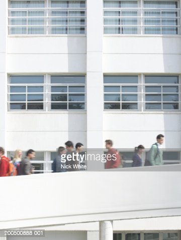 Students on walkways at university,  outdoors (blurred motion) : Stock-Foto