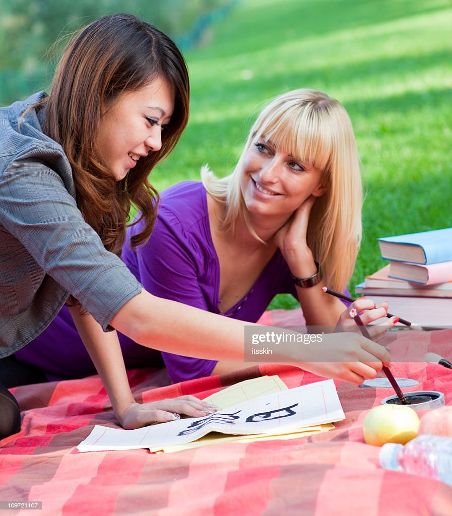 Students outdoors : Stock Photo