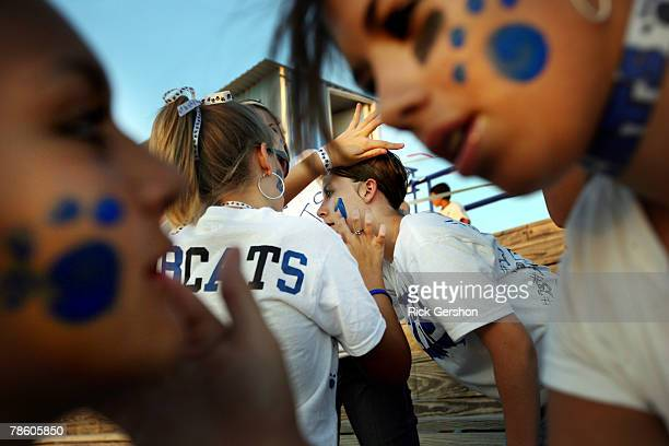 Students paint each other's faces before the six man football matchup between the Rule Bobcats and the Throckmorton Greyhounds on October 12 2007 in...