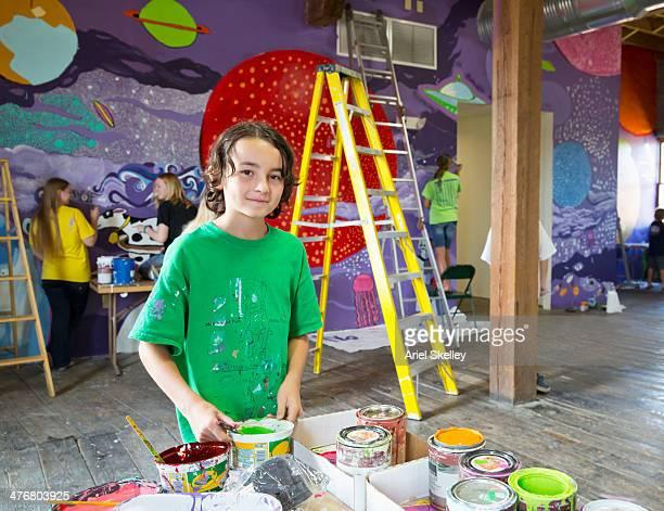 Students painting mural in studio