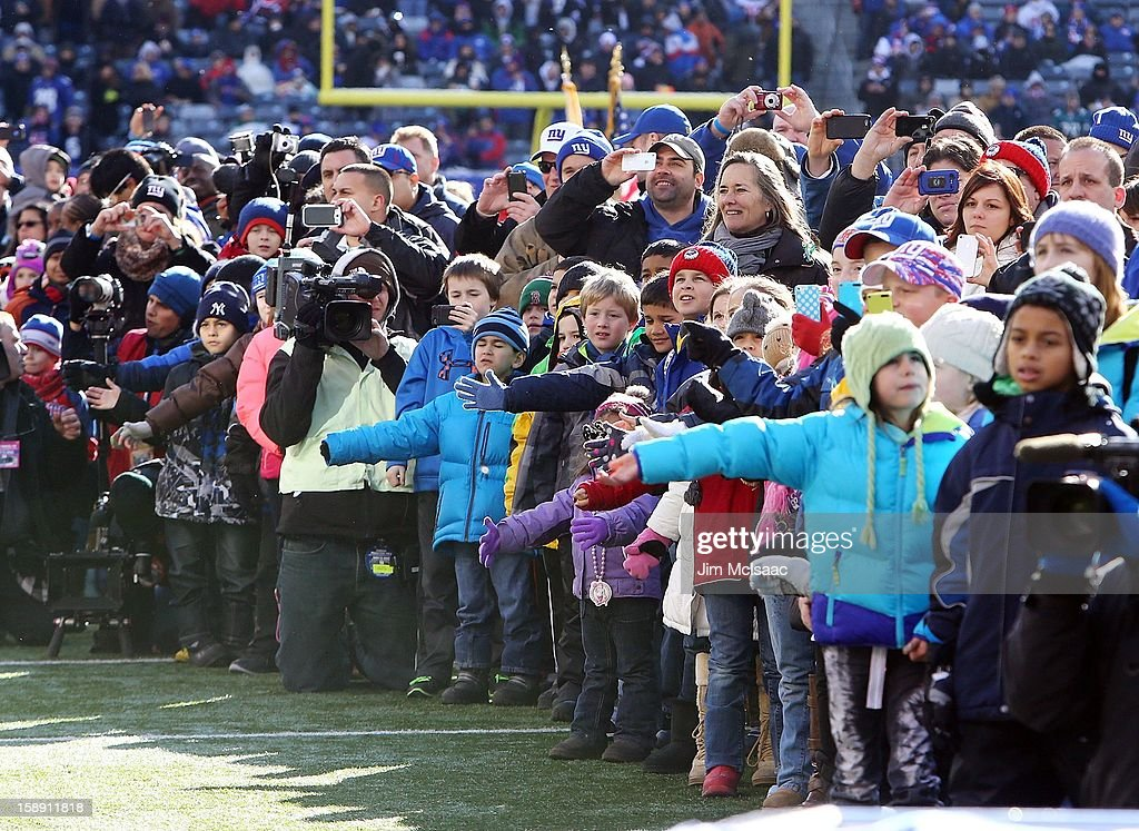Students, parents and faculty of Sandy Hook Elementary School as well as residents of Newtown, Connecticut attend the NFL game between the New York Giants and the Philadelphia Eagles at MetLife Stadium on December 30, 2012 in East Rutherford, New Jersey. The Giants defeated the Eagles 42-7.