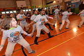 Students participate during the NBA Cares event with Felipe Lopez and Mitch Richmond at PS 208 on December 11 2014 in New York New York NOTE TO USER...