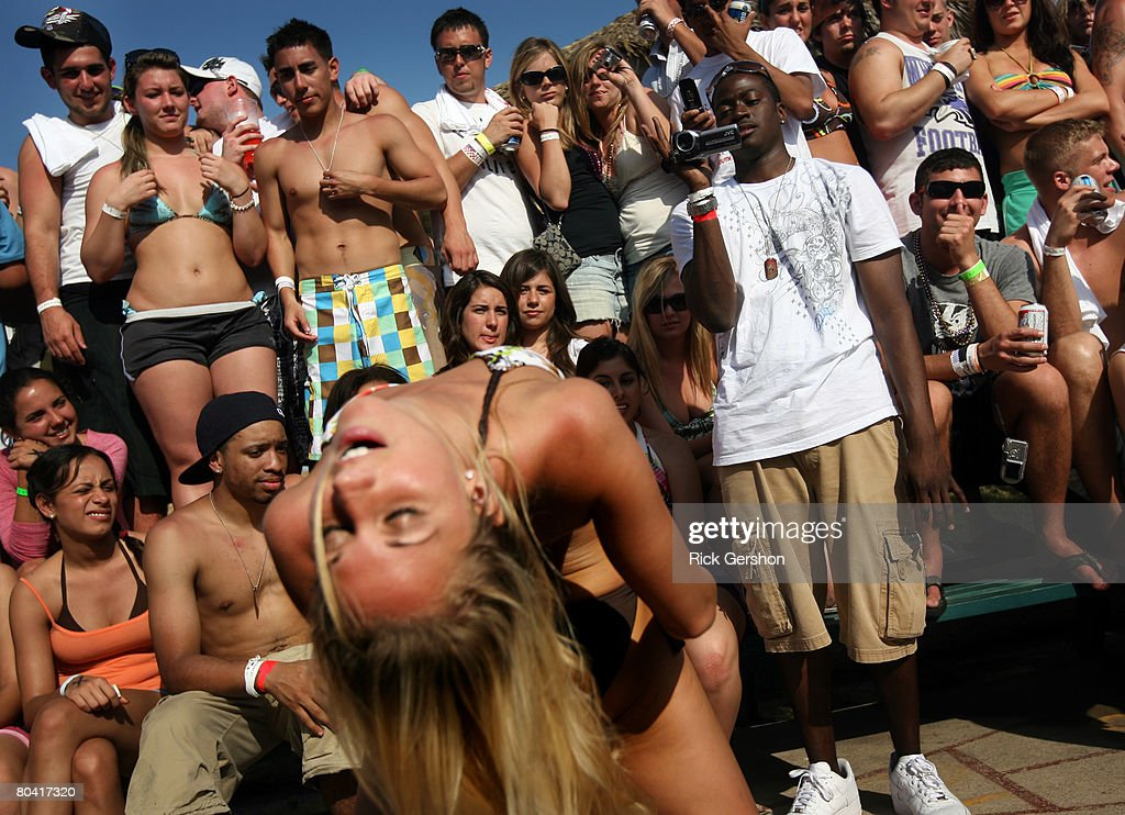 Students participate in a 'booty shaking' contest at the MTV Beach Bash party put on by Global Groove at the Bahia Mar Hotel during the annual ritual...