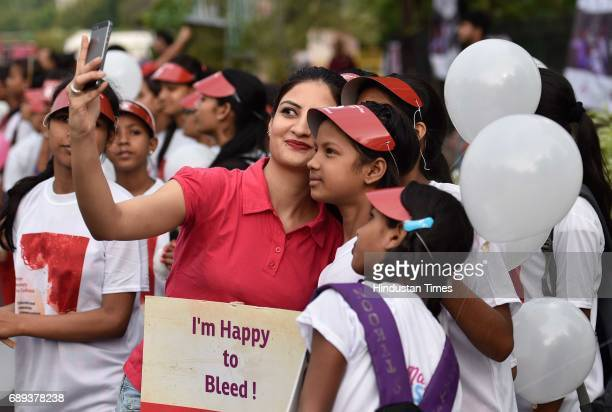 Students participate in a rally on World Menstrual Day at Connaught Place on May 28 2017 in New Delhi India Menstrual hygiene day is an annual...