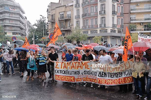 Students participate in the demonstration under heavy rain Hundreds of teachers gathered in front of the Ministry of MacedoniaThrace protesting...