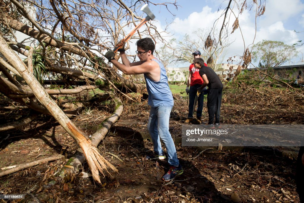 Students participate in voluntary cleaup works at the University of Puerto Rico on October 3, 2017. The campus sustained damages after Hurricane Maria.