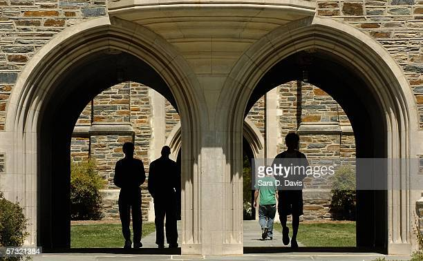 Students pass under the arches at Duke University Tuesday April 11 2006 in Durham North Carolina The investigation into the Duke lacrosse players...