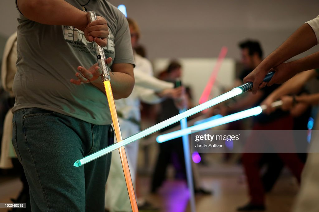 Students perform combat moves using lightsabers during a Golden Gate Knights class in saber choreography on February 24, 2013 in San Francisco, California. Star Wars fans Alain Bloch and Matthew Carauddo founded the Golden Gate Knights in 2011 to teach classes on how to safely wield a lightsaber and perform choreographed moves. The three hour class costs ten dollars and all equipment is provided.