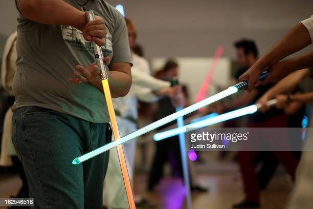 Students perform combat moves using lightsabers during a Golden Gate Knights class in saber choreography on February 24 2013 in San Francisco...