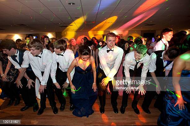 Students perform dance routines to the song 'Macarena' on the dancefloor at St James' Park on July 1 2011 in Newcastle United Kingdom After months of...