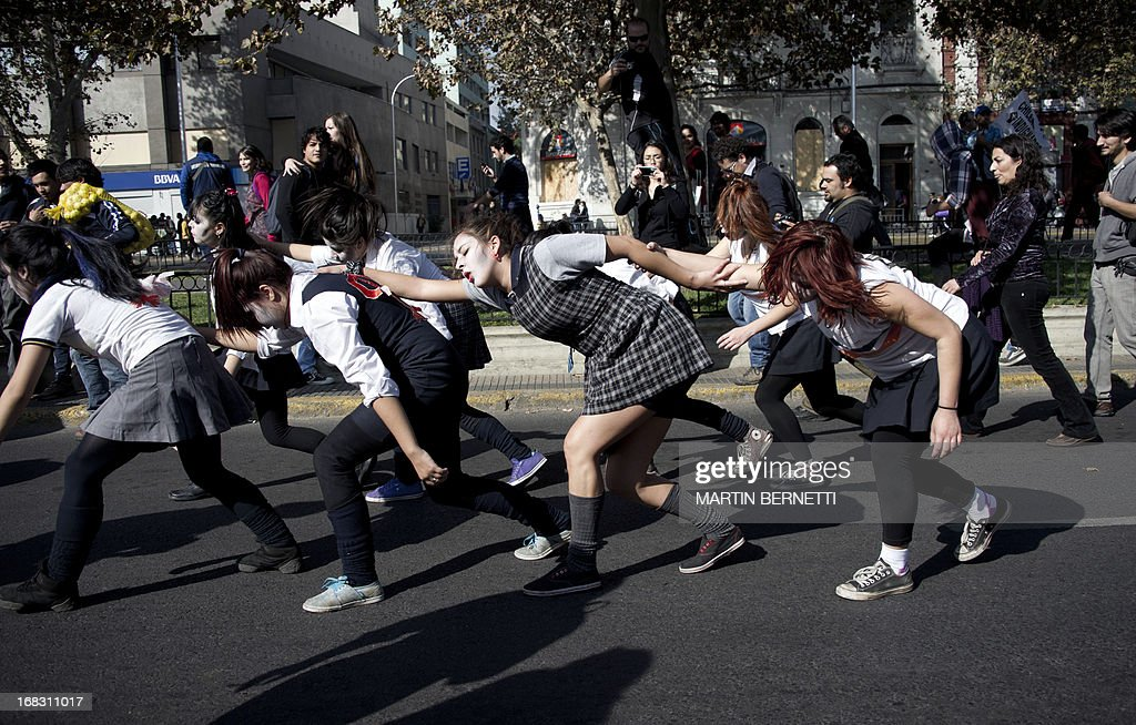 Students perform during a protest to demand Chilean President Sebastian Pinera's government to improve the public education quality, in Santiago, on May 08,2013. AFP PHOTO / MARTIN BERNETTI