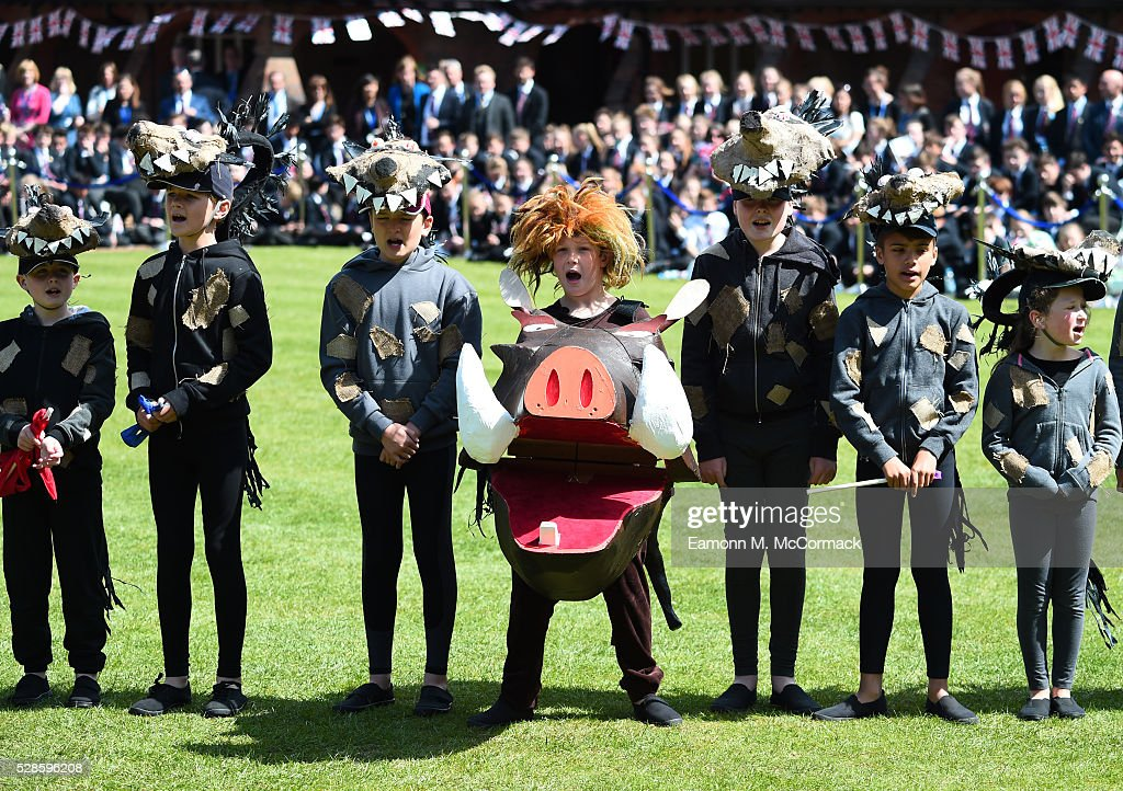 Students perform for Queen Elizabeth II at Berkhamsted School as part of the School's 475th Anniversary celebrations on May 6, 2016 in Berkhamsted, England.