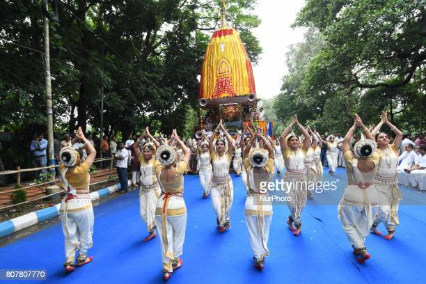 Students perform Odissi Dances at the ISKCON 46th Ultta Rath Yatra on July 032017 in Kolkata IndiaThe three deities of Jagannath Balabhadra and...