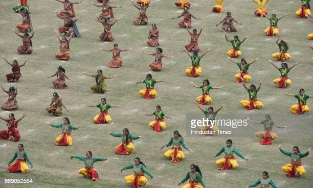 Students performing during Karnataka Rajyotsava celebration at Kranteerava stadium on November 1 2017 in Bengaluru India All the Kannada...