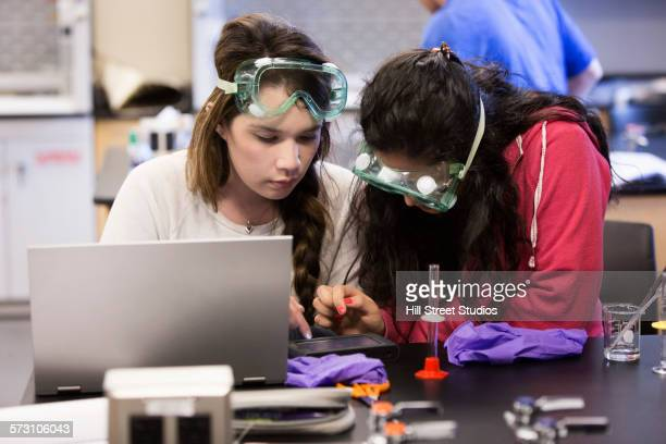 Students performing experiment in science lab