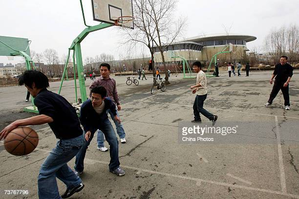 Students play basketball on the the campus of Jilin University on April 1 2007 in Changchun of Jilin Province China Jilin University a key university...