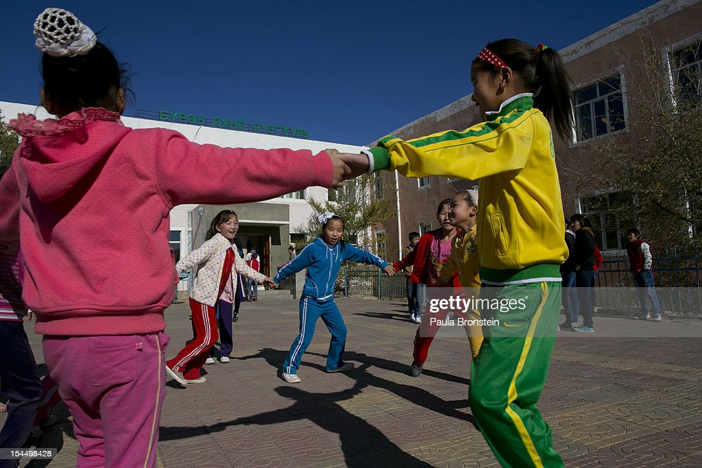 Students play during a physical education program at the Khanbogd Secondary school on October 13, 2012 in Khanbogd, Mongolia. The population of Khanbogd has doubled in the last few years along with the secondary school adding a new extension to accommodate the growing number of students since Oyu Tolgoi employs most of the people in the town.The Oyu Tolgoi copper and gold mine (translated means Turquiose Hill) is a combined open pit and underground mining project. While the construction continues open pit mining is currently underway with full production expected later in 2012. When the mine starts full operation the country will be set to become one of the world's top copper and gold producers with estimates of 450,000 tons of copper and 330,000 ounces of gold. Financing for the project has come in part from the Rio Tinto Group and an investment agreement between Ivanhoe Mines and the government of Mongolia. Mongolia's largest foreign investment project to date which is projected to add one-third of future value to the country's GDP. Many estimate Mongolia to be the world's fastest growing economy with an estimated $1.3 trillion in untapped mineral resources.