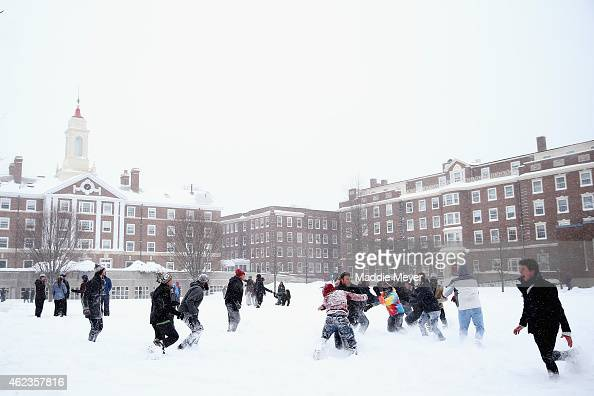 Students play football at the Quad on the campus of Harvard University on January 27 2015 in Cambridge Massachusetts Boston and much of the Northeast...