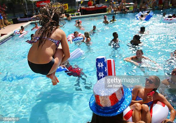 Students play in the campus pool prior to the debate between US President Barack Obama and Republican presidential candidate Mitt Romney at Lynn...