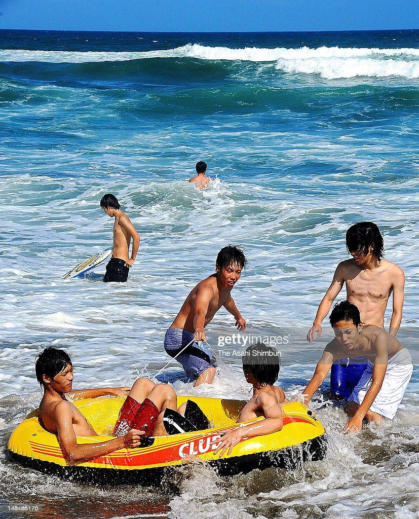 Students play in the sea on July 17, 2012 in Kuroshio, Kochi, Japan. Japan Meteorological Agency announced that the rainy season seems finish in most of the area in Japan.