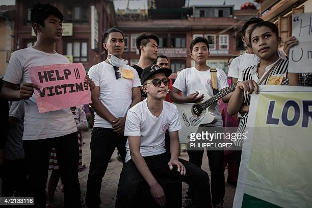 Students play music to raise funds for the earthquake victims during the Buddha Purnima religious day outside the Boudhanath stupa a touristic...