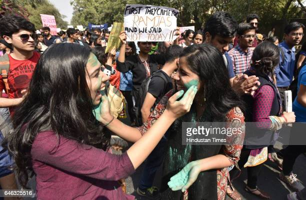 Students playing colours during the AISA JNUTA and Delhi University Students' protest march against ABVP wing after 22nd February issue from Khalsha...