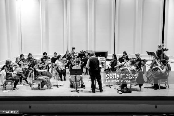Students playing in college orchestra