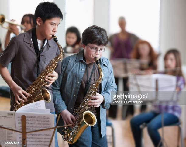 Students playing saxophones in music class