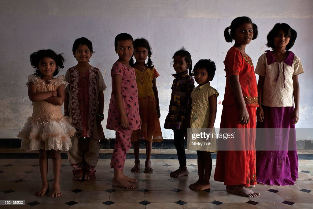 Students pose for a photo at the Aarti Home shelter on February 23, 2013 in Kadapa, India. Female infanticide is still prevalent in rural areas of India. The abuse of the dowry tradition has been one of the main reasons for sex-selective abortions and female infanticides in India.