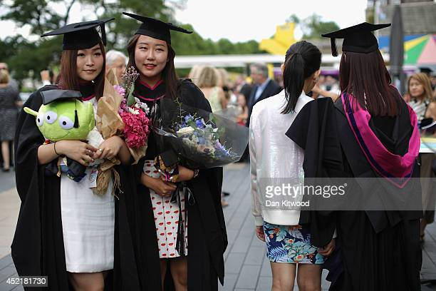 Students pose for photographs ahead of their graduation ceremony at the Royal Festival Hall on July 15 2014 in London England Students of the London...