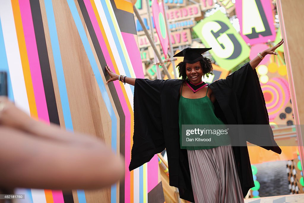 Students pose for photographs ahead of their graduation ceremony at the Royal Festival Hall on July 15, 2014 in London, England. Students of the London College of Fashion, Management and Science and Media and Communication attended their graduation ceremony at the Royal Festival Hall today.